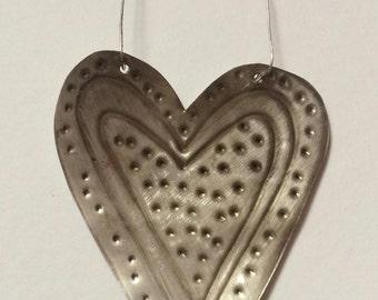 small silver heart,