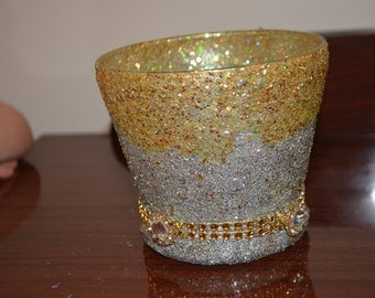gold and silver candle holder