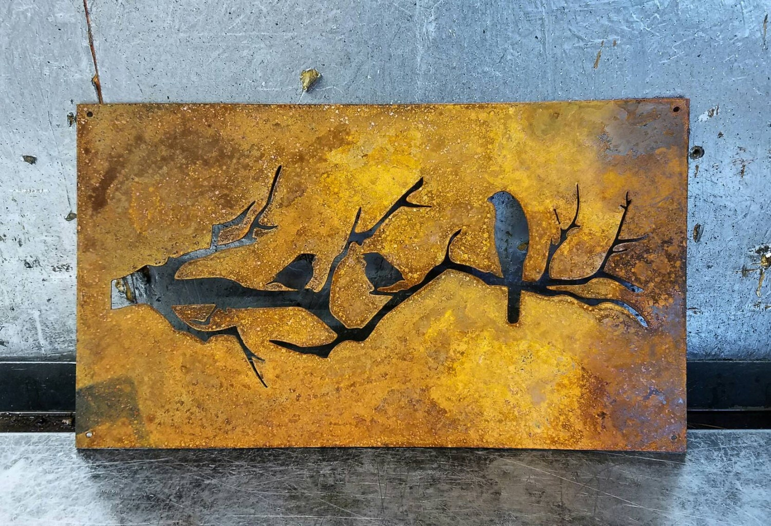 Birds On A Branch Silhouette Cut Out Of A Sheet Of Metal