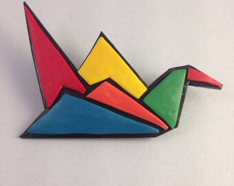 Colored origami crane shaped brooch