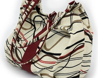 Handcrafted women's handbag made of cotton and genuine leather