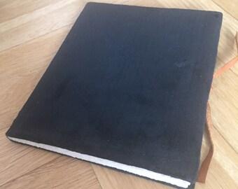 Hand bound black velvet book