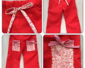 Girls red draw string trousers