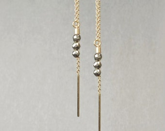 Pierced earrings gold 14 k and Pyrite beads *.