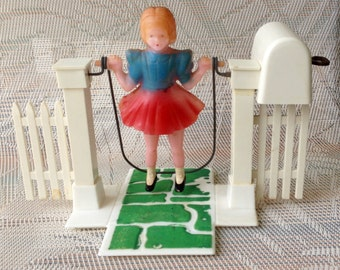 Rare 50's Toy Celluloid Wind Up Girl Jumping Rope