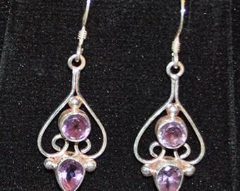 Silver earrings with amethyst settings