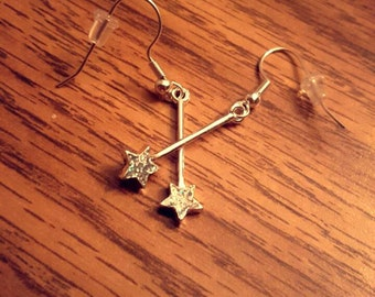 Sparkly silver star dangling earings