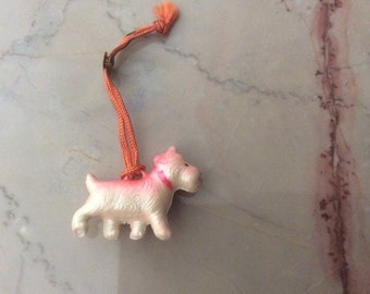 Tiny Plastic Scottish Terrier Dog with cord - vintage