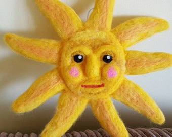Needle felted wall hanging sun