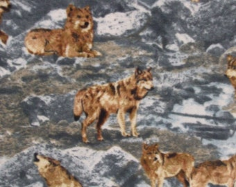 Wolf Fleece Fabric...Badlands Wolf Fleece Fabric Wolves on Rocks Mountains.