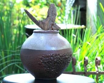 Raku pottery figurehead driftwood