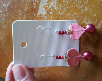 Pink origami heart earrings.
