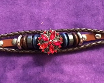 New Genuine Leather bracelet with a red snap