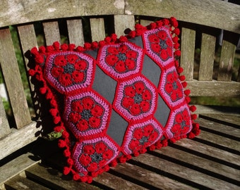 Fabulous and bright crocheted African flower cushion in dark grey linen/cotton mix fabric with red, grey and pink 100% merino wool