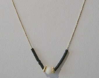 White Center Stone Necklace With Black Beads