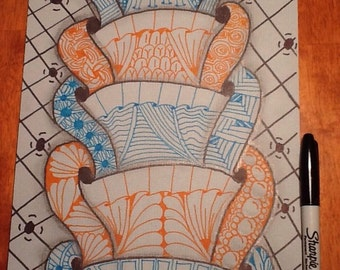 Light blue and orange Zentangle inspired art