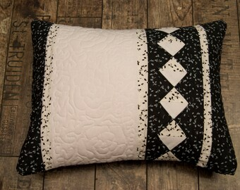Black and white cushion with quilting roses