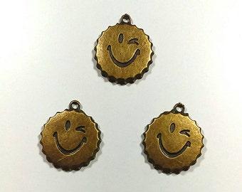Smiling bottle cap pendant