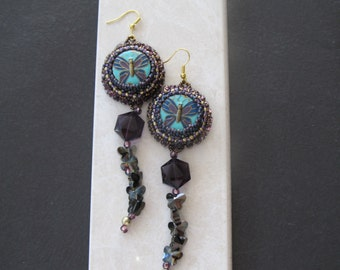 One of a kind bead embroidered earrings with bead and butterfly charm tassel.