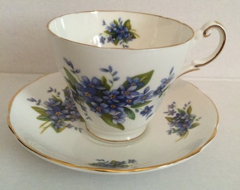 Regency English bone china teacup and saucer, forget me not pattern, made in England