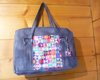 Small rectangular, gray and multicolor bag