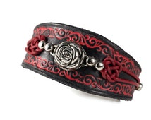 Exclusive leather strap in black and red with a pink silver and Red Celtic knot