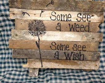 Lath sign. Some see a weed. Some see a wish.