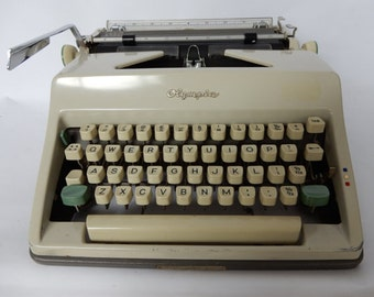 A Vintage Olympia Typewriter, in case, good condition.Desk addition, collectable