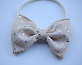 Gold polka dot bow