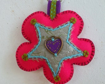 pop rose felt Keychain bag hanger in the shape of a flower filled with wool