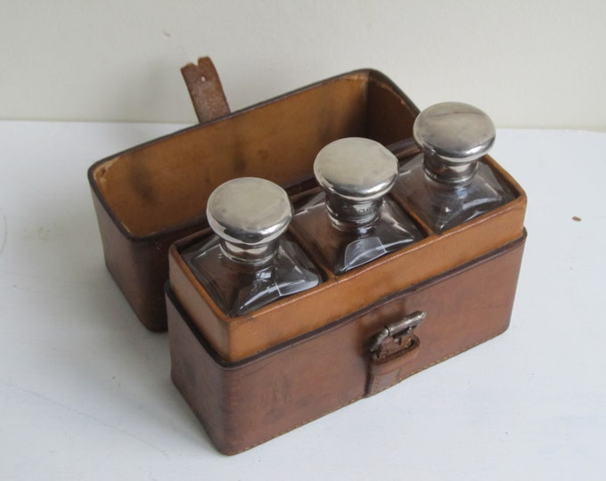 Antique vanity set, Leather cased glass bottles, silver topped bottles, Hallmarked London 1908, with residue scent inside the bottles!