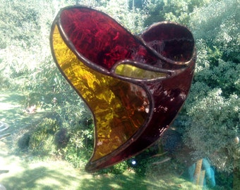 Lovely stained glass heart in orange and reds