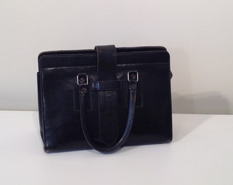 Woman vintage bag black leather