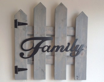 Picket Fence with Metal Family Sign