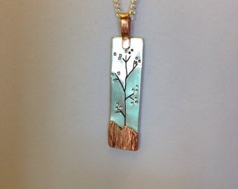 Sterling silver and copper drop pendant