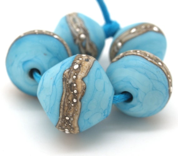 Graduated turquoise and silvered ivory beads.