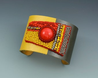 Bead embroidery cuff bracelet. Red, gray, and yellow cuff.