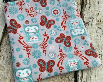 Aqua owls and red butterflies square zipper pouch