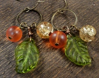 Green leaves, tangerine orange frosted beads and gold glass antique brass ring handmade earrings