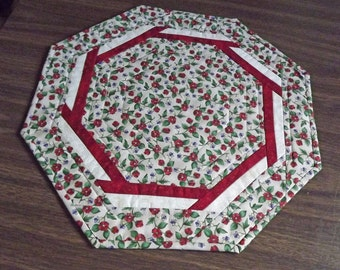 Quilted table topper.  Table topper with flowers.