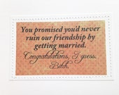 Wedding card. You promised you wouldn't ruin our friendship by getting married.