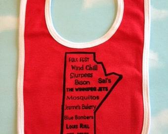 Winnipeg childrens bib of Manitoba outline and local landmarks. Silk screened baby bib.