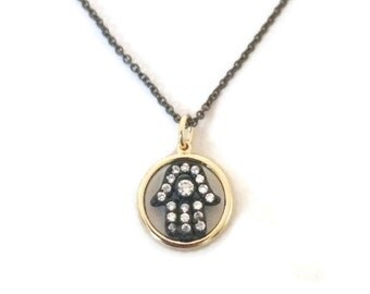 Small pave cubic zirconia hamsa or eye silver and gold necklaces