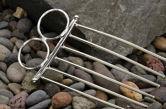 Hair fork or hair comb hair accessory made of nickel silver with curly design