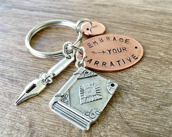 Embrace Your Narrative Keychain Copper with book and pen charms, author gift, novelist gift, journalist gift, writer gift, writer's keychain