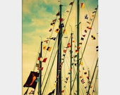 Holiday Sale Nautical Flags: fine art photograph print of sailboat masts decorated with colorful flags against sky with clouds
