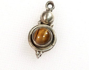 Sterling silver pendant with 8 mm brown tigereye cabochon