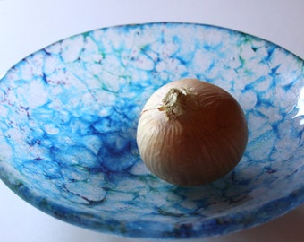 large watery blue cast glass fruit bowl