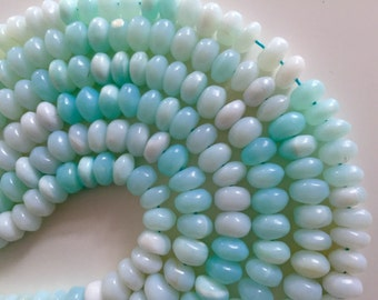 1/2 strand lite smooth peruvian opal roundels 20.00