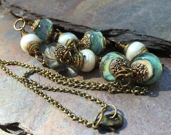 Tibetan capped Pearls, green Lampwork and brass NECKLACE